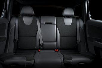 Back passenger seats in modern luxury car, black upholstery