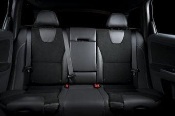 Back passenger seats in modern luxury car, black upholstery